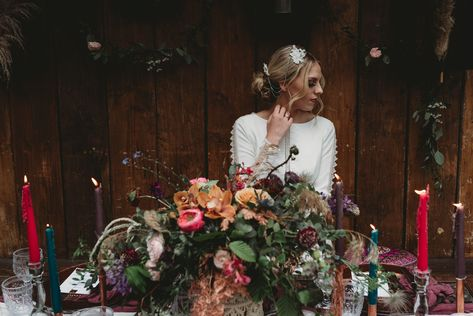 Head to the blog now for boho wedding styling in an industrial setting. bohemian flora, jewel tone wedding styling. #bohowedding #bohoweddingstyling