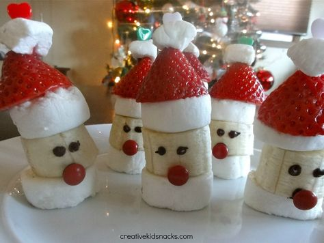 """These yummy """"Santa Party Poppers"""" treats can be made using the following ingredients:  marshmallows, bananas, strawberries, mini M (red), chocolate chips (for melting), and toothpicks.  From:  Creative Kids Snacks"""
