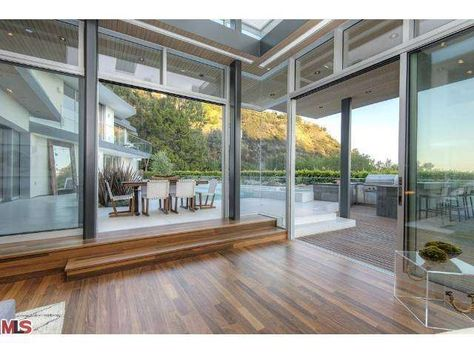 Beautiful custom hard wood floors lead to an indoor/outdoor living space. Also, notice the on trend clear furniture.  Los Angeles, CA Coldwell Banker Residential Brokerage $10,400,000