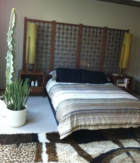 Use A Decorative Mid Century Living Room Screen As Headboard Night Table Lamps And Duvet