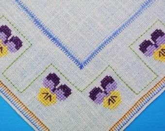 Very well done vintage 1960s handmade cross-stitch embroidery tablettable-cloth w small flower frame in turqouise blue on bone white bottom