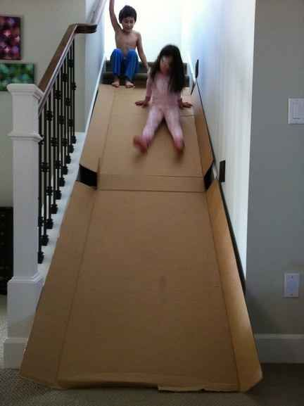 Turn an old box into an indoor slide.