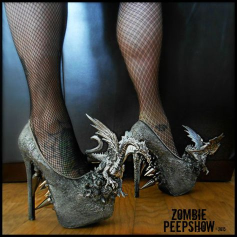 These ZombiePeepshow metallic Dragon platform pumps are hand painted and texturized. They feature mounted intricate dragon pieces with custom painted detail, assorted steel spikes, and.