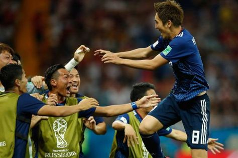 TOPSHOT Japan's forward Genki Haraguchi celebrates with teammates after scoring during the Russia 2018 World Cup round of 16 football match between...