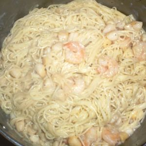Shrimp & Scallop Alfredo Angel-Hair Pasta -A seafood version of Alfredo Pasta! Shrimp & scallops simmered in butter & alfredo sauce makes this recipe delectable! Serve with fresh, hot Italian loaf bread.