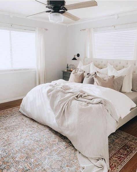 cottage bedroom design with neutral bedding and tufted upholstered headboard with white walls, farmhouse ceiling fan, farmhouse master bedroom neutral bedroom decor Neutral Bedroom Decor, Neutral Bedding, Neutral Bedrooms, White Bedding, Cozy Bedroom, Home Decor Bedroom, Bedroom Ideas, Masculine Bedrooms, White Bedrooms