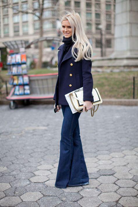 Navy pea coat, gold buttons, wide leg jean, turtleneck.