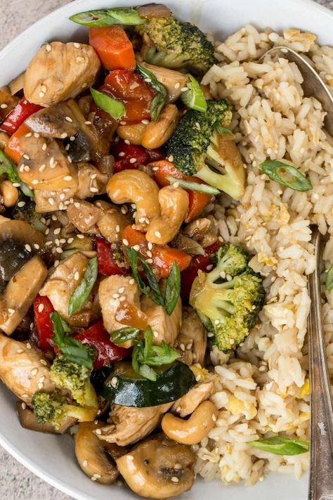 This easy Chicken Stir Fry recipe is amazing! Chicken with vegetables smothered in the most delicious garlic and ginger honey soy sauce. So much better than takeout and ready in 30 minutes.