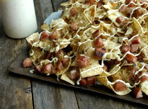 Sauerkraut and Kielbasa Nachos with Cracked Pepper Dijon Cream.41 Easy New Year's Eve Appetizers | Looking for easy party appetizers, finger foods, and canapes for a crowd? These make ahead party appetizers are perfect for New Year's Eve party, for birthdays and other holiday parties. You can find party appetizers: garlic cheese bread, dips, cold appetizers and cheap snacks if you're on a budget. #partyappetizers #fingerfood #canapes #newyearseve #appetizers