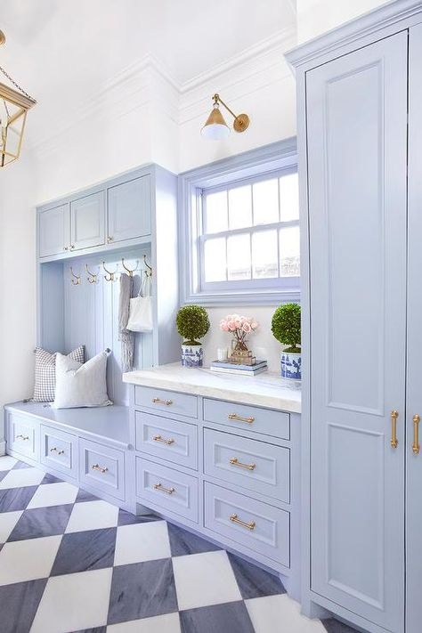 Katie Nixon Photography - Blue mudroom bench features brass hooks built-into blue cabinets with honed white marble countertops. Katie Nixon Photography - Blue mudroom bench features brass hooks built-into blue cabinets with honed white marble countertops. Mudroom Laundry Room, Laundry Room Design, Bench Mudroom, Mudroom Cabinets, Mudrooms With Laundry, Laundry Room Floors, Laundry Cupboard, Laundry Box, Mudroom Cubbies