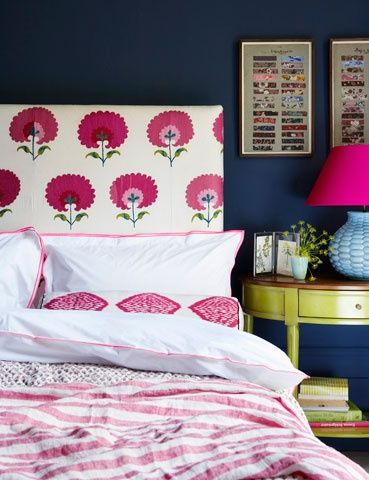 Madeline Weinrib Pink Carnation Suzani Fabric headboard with Pink Dodi Ikat bolster, photo by Rachel Whiting for House & Garden UK
