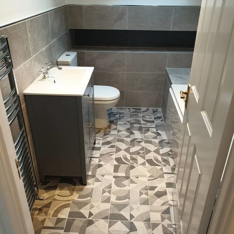 Choose Bathroom Schemes That Look Stylish And Make You Happy This Grey Scheme With Patterned Floor Tiles And Coordinated Wal In 2020 Floor Patterns Tile Floor Tiles