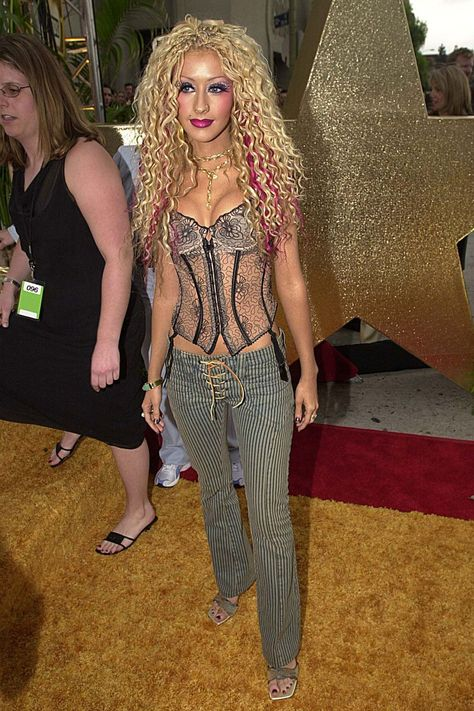From pashminas to cargo pants, we reflect on 15 fashion trends from the we wish we could forget we ever wore. Take it away, Britney Spears, Mischa Barton and Christina Aguilera.