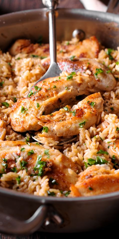 Chicken with Garlic Parmesan Rice is the perfect dish for easy weeknight dinners. #chicken #rice #easymeals #garlic #parmesan Ingredients: chicken tenders Salt and pepper 1/2 teaspoon garlic powder 2 tablespoons olive oil 1/2 cup butter (1 stick) 2 tablespoons minced garlic 1/4 teaspoon red pepper flakes 1 teaspoons salt divided 1/2 cup dry white wine 1 1/2 cups white rice (uncooked) 3 cups chicken broth 1/2 cup Parmesan cheese