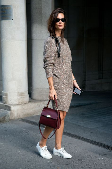 See how to pull off a sweater dress with sneakers with street style inspiration from Hedvig Opshaug.