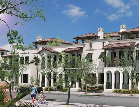 Florida shutters and tile-roofed balconies add timeless appeal to these newly built townhomes from CC Devco. The Townhomes of Downtown Doral. Miami, FL.