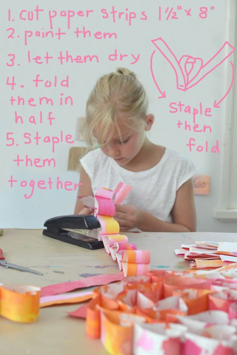 The kids made these heart paper chains and they totally became immersed in the process. First we painted the strips of paper which they liked but didn't lov
