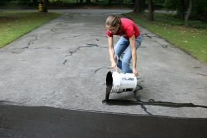 Diynetwork Com Gives You Simple Step By Step Instructions For Filling Cracks And Resealing A D Driveway Repair Asphalt Driveway Repair Repair Concrete Driveway