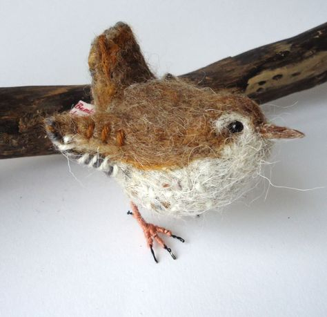 """I think this bird has been really well recreated in felt, and the body is in very good proportion. I like how they have used wool thread to add detail on the wing, and I like how they have used a bead for the eye to give the bird character."""
