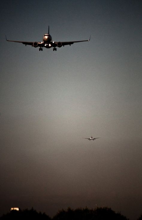 This photo reminds me of the Philadelphia Airport where you can watch the planes coming in, one right after another.