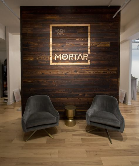 Office Reception TORA shou sugi ban cypress installed as a feature wall and counter facade Office Reception Design, Modern Office Design, Office Interior Design, Office Interiors, Home Interior, Office Designs, Salon Reception Area, Office Wall Design, Reception Backdrop