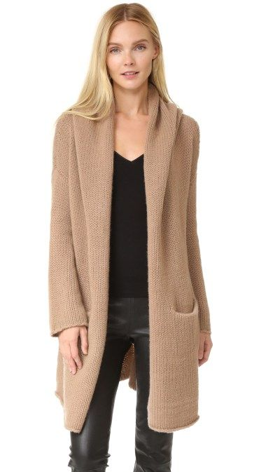 Camel cashmere cardigan, black top and leather pants for fall and winter.