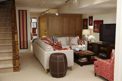 Neutral with red accents - basement living area by Sarah Richardson