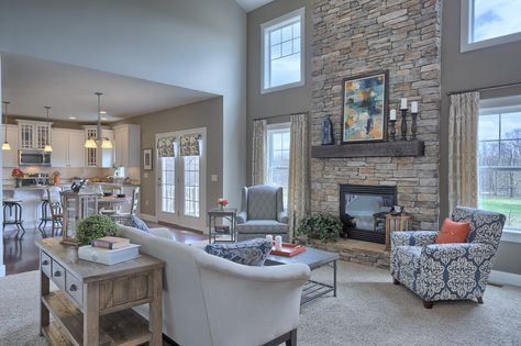 Great Room with 2-story ceiling. Gas fireplace with stone surround and raised hearth. #ownalandmark #projectdreamhouse