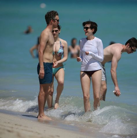 It's great to see Anne Hathaway protecting her skin on the beach recently. Would you go this far or do you rely on broad spectrum sunscreen to be #skinsmart?