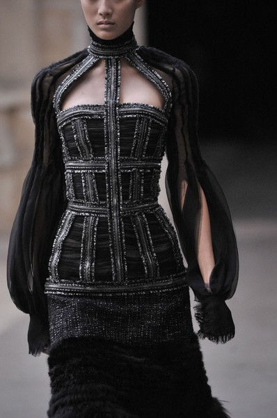 Elegant structuring, black dress with mixed materials, gathered textures flowing sleeves // Alexander McQueen