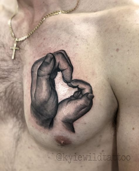 two hands together make heart shape, father and daughter tattoo on chest, black and grey realism by Kylie Wild Heslop, Canberra, Australia based tattoo artist