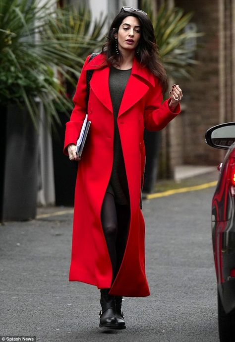 Amal Clooney was photographed in London wearing a red coat and leggings, marking her first outfit since confirming she and husbang George are pregnant with twins.