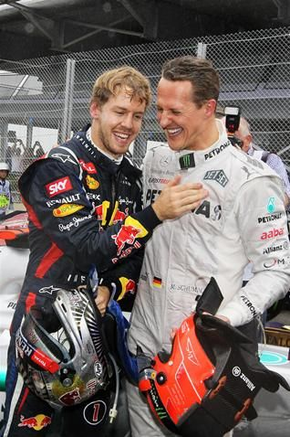 World Champion Sebastian Vettel (GER) Red Bull Racing celebrates in parc ferme with Michael Schumacher (GER) Mercedes AMG F1.  Formula One World Championship, Rd20 Brazilian Grand Prix, Race, Sao Paulo, Brazil, 25 November 2012