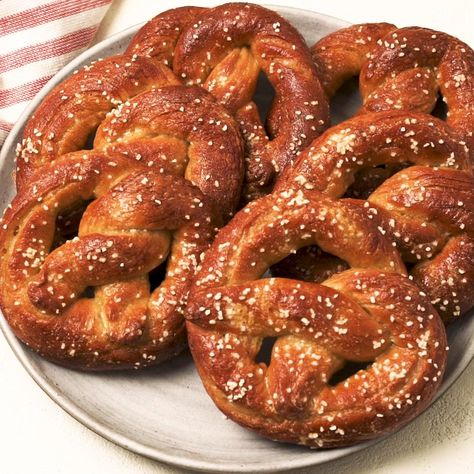 Homemade soft pretzels are better than any mall pretzel you can find. Soft and pillowy, they are a dream for sipping in mustard or nacho cheese. Full recipe on Delish.com.