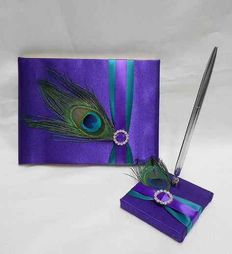Peacock weddings guest book and pen set purple and turquoise peacock feather wedding decorations.