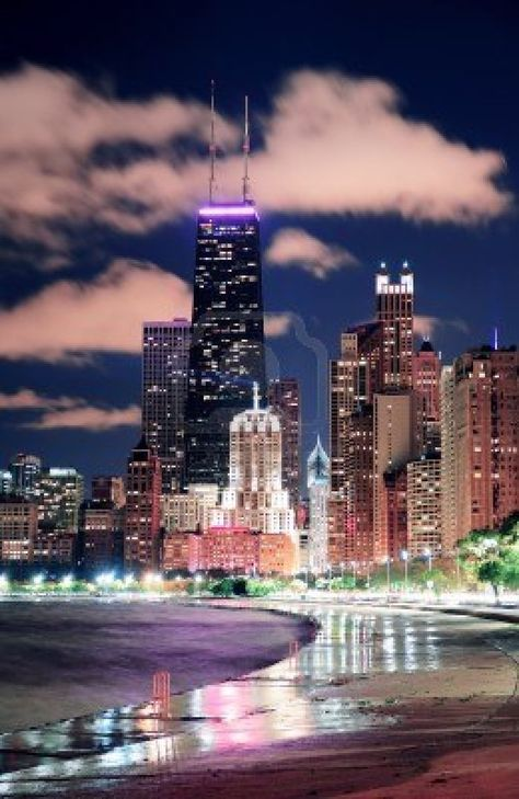 Picture of Chicago city urban skyscraper at night at downtown lakefront illuminated with Lake Michigan and water reflection viewed from North Avenue Beach. stock photo, images and stock photography.