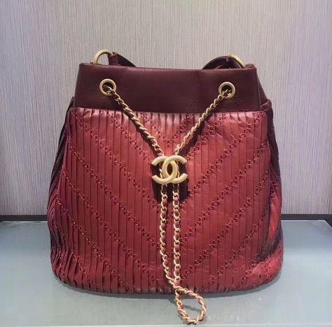 fashionistas Chanel Burgundy Drawstring bag...