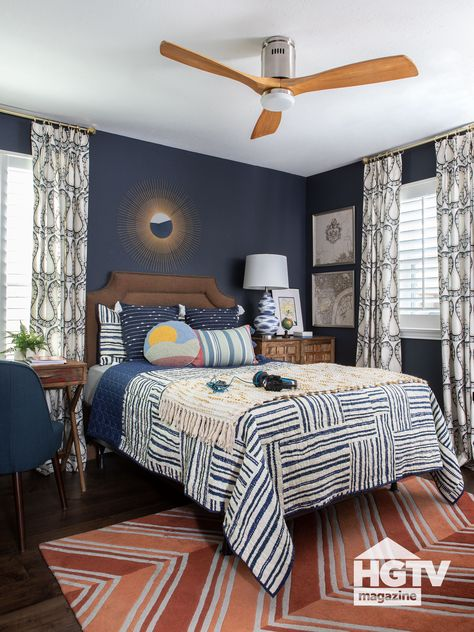 dark blue and burnt orange fabrics meld together in this traditional style guest bedroom. See more on HGTV.com.