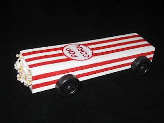 Pinewood derby car - box of popcorn, omg this has to he for Lainey we have this container and she eats popcorn everyday.