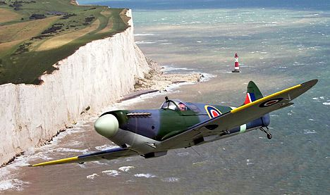 A Supermarine Spitfire Mk V flies over the White Cliffs of Dover, in tribute to the courage of 'The Few' who fought over the skies of Kent in the Battle of Britain