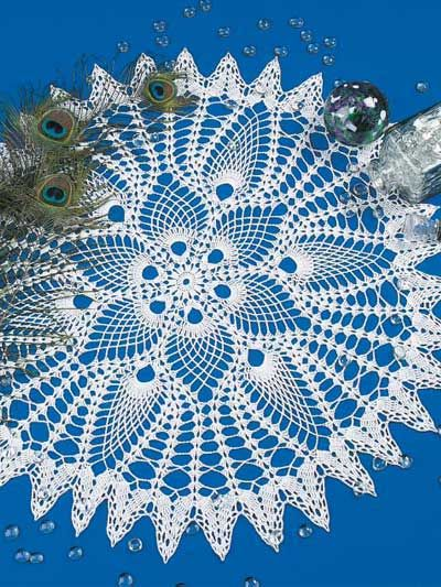Pineapple motifs are reminiscent of elegant peacock fans!Doily size: 31 inches (appx)Skill level: Intermediate