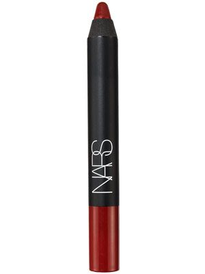NARS Velvet Matte Lip Pencil in 'Cruella' is the best vibrant red lipstick for olive to medium dark skin tones.