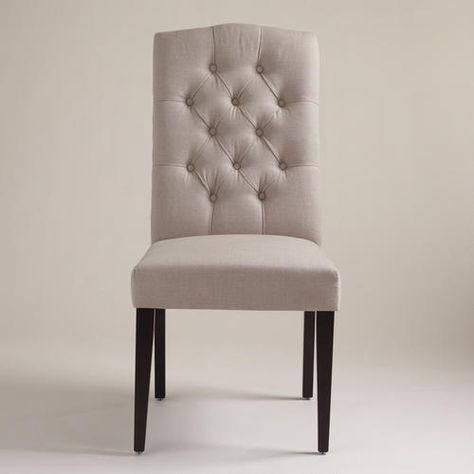 Beautiful gray tufted dining chairs.