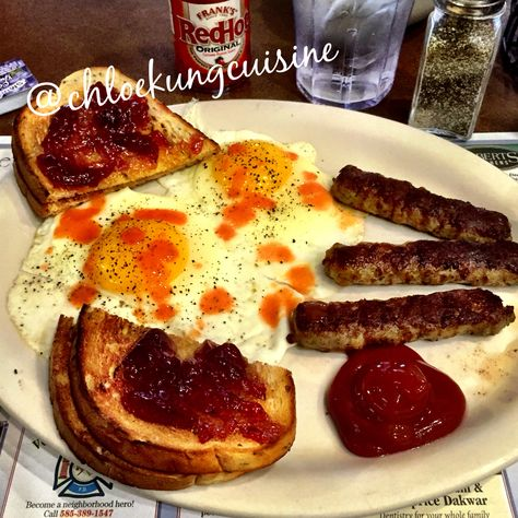 Early Morning Breakfast Organic Sunny Side Up Eggs, Buttered Rye Toast with Grape Jam, and Country Sausage Links. Yummee!