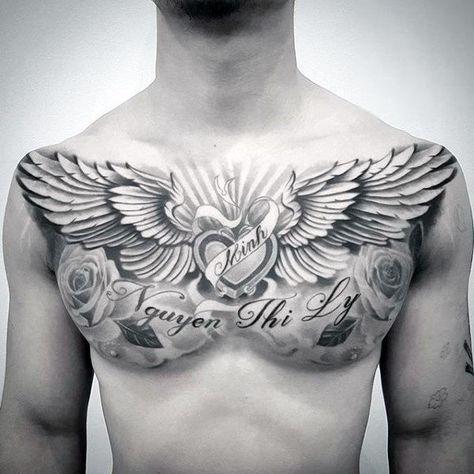 Memorial Guys Wing Heart Upper Chest Tattoo Ideas tattoo for men on chest 40 Wing Chest Tattoo Designs For Men - Freedom Ink Ideas