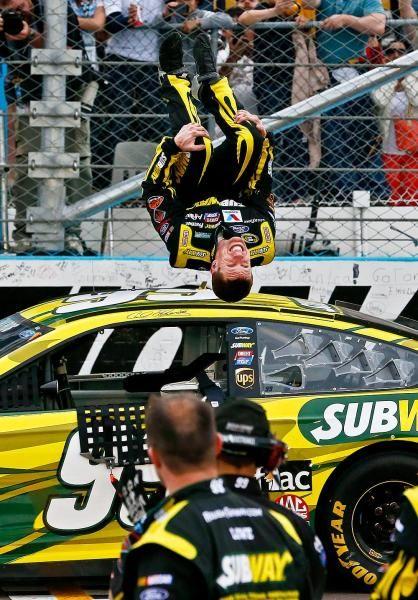 Carl Edwards doing his signature backflip after winning a race.