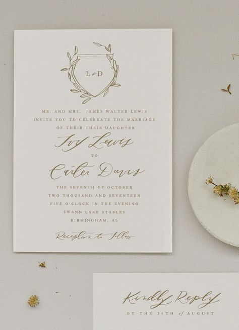 Sophisticated elegance meets organic. Ivy presents a classic crest entangled with greenery. This suite has a perfect mix of calligraphy and type. A mix of clean lines with organic touches. The Ivy Invitation allows for customized: Paper Color, Hand Torn or Straight Edge Paper, Calligraphy, Ink Color