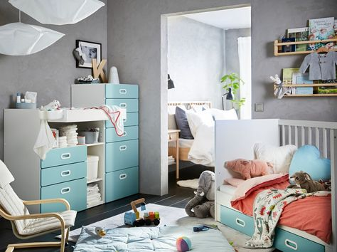 c210ca1213ec A blue, grey, red and white nursery with a white and light blue STUVA/FRITIDS  changing table, chest of 6 drawers and cot. #nursery #babyfurniture #ikea  #ad