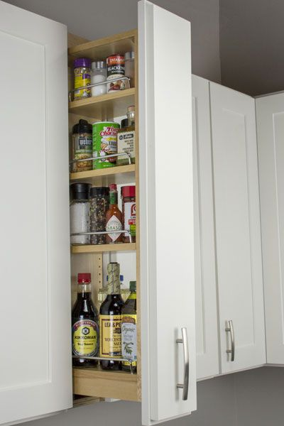 Pull Out Storage Cabinet Pull Out Spice Rack Shelves Cliqstudios In 2020 Pull Out Spice Rack Cabinet Spice Rack Kitchen Spice Storage