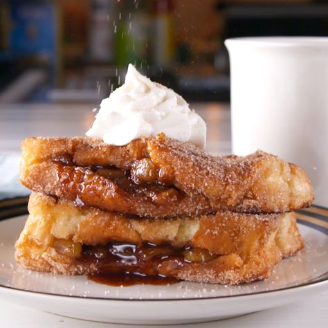 Apple pie for breakfast?! With this easy stuffed French toast, that dream can become a reality! We like it with a dollop of whipped cream, but if you're feeling extra, try it a la mode! Get the recipe at Delish.com. #delish #easy #recipe #breakfast #brunch #fallrecipe #applepie #apple #pie #frenchtoast #syrup #brioche #cinnamon